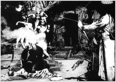 A scene from the 1913 film, Raja Harishchandra. The image in the article banner is of the painting Harishchandra by Raja Ravi Varma.