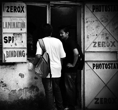 Students outside a photocopying enterprise in Delhi University Photograph by Shilpi Boylla